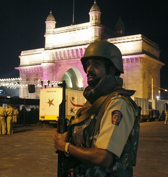 An armed policeman guards near the Gateway of India in Mumbai